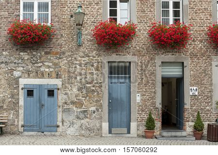 Doors To Buildings And Red Flowers In Aachen