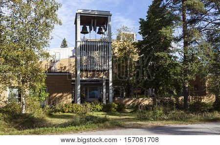 UMEA, SWEDEN ON AUGUST 30. View of a modern church, belfry, building on August 30, 2016 in Umea, Sweden. Trees and bushes along the road, street. Editorial use.