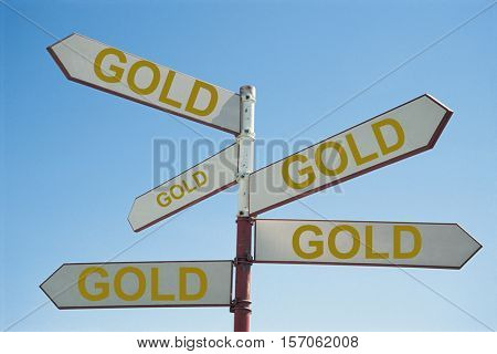 Metal Sign Post with Text Saying Gold
