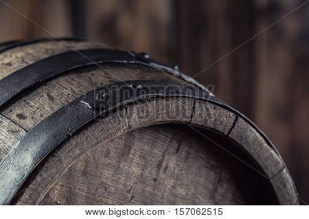 Wooden barel. Old wooden keg. Barel on beer vine whiskey brandy or cognac.