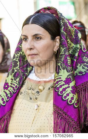 QUARTU S.E., ITALY - September 17, 2016: Parade of Sardinian costumes and floats for the grape festival in honor of the celebration of St. Helena. - Sardinia - portrait of a beautiful woman in traditional Sardinian costume
