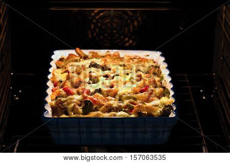 Baked pasta with ham and cheesy in the oven