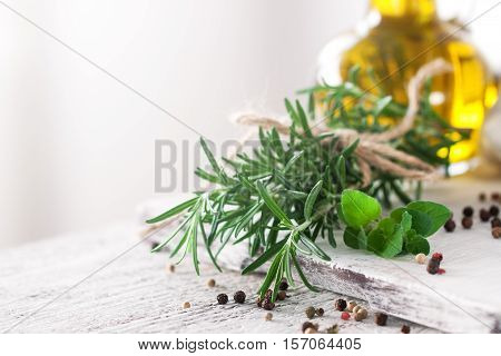 Healthy ingredients on a kitchen table - spaghetti olive oil spices and fresh italian herbs on a shiny background. Cooking home cooking or healthy life concept horizontal