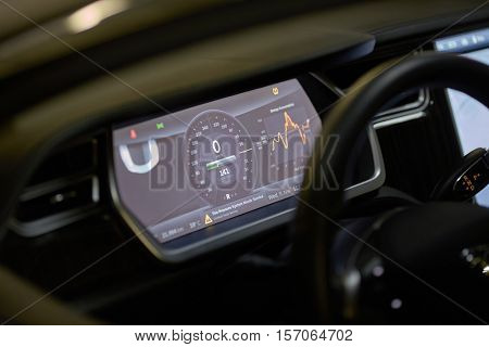 MOSCOW, RUSSIA - NOV 11, 2015: Main dashboard display of electric car Tesla Model S. The Tesla Model S produced by Tesla Motors, and introduced in June 2012.