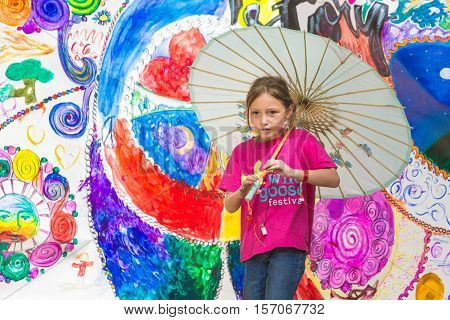 Girl Carrying Umbrella At The Wild Goose Festival