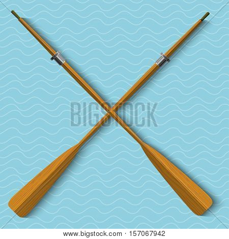 Two wooden oars on abstract blue wavy background