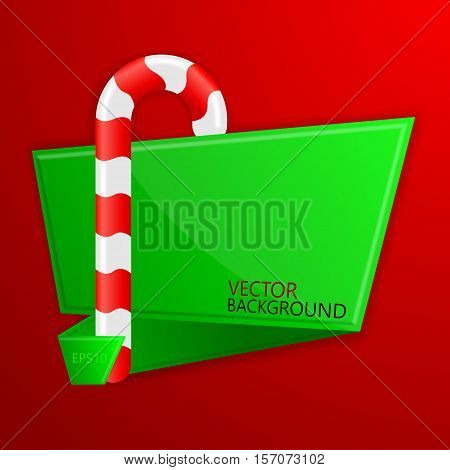 Red and white candy cane on a background of green flyer in origami style.Christmas banner.