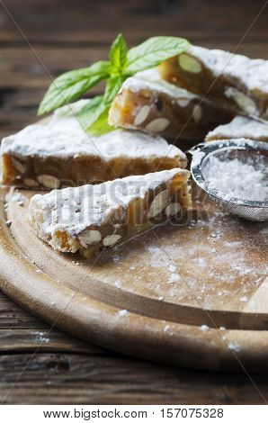 Traditional italian dessert panforte with nuts selective focus