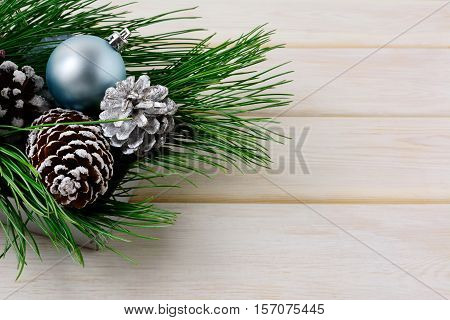 Christmas background with blue ornaments silver and snowy pinecones. Christmas table decorated centerpiece. Copy space.