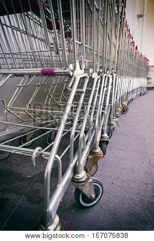 row of shopping trolleys or shopping carts in supermarket