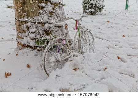 The bicycle was left in the snow, winter scene of the Zrinjevac park in Zagreb.