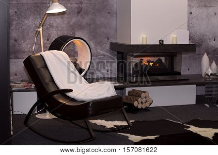 modern interior with rocking chairs and a decorative electric fireplace