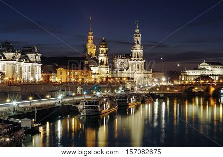 Scenic night view of the Old Town architecture with Elbe river embankment in Dresden Saxony Germany