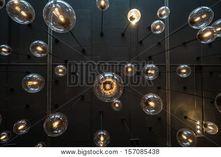 Bottom view of light bulbs background over dark wall