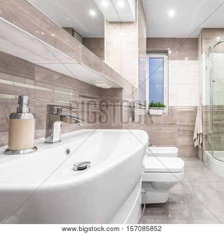 Bathroom With Beige Tiles