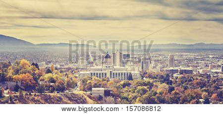 Vintage Toned Panoramic Picture Of Salt Lake City Skyline.
