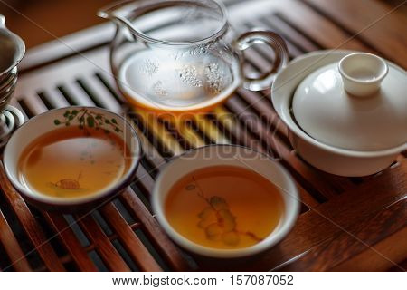 Asian tea set on wooden table. tea board, tea-table. Asian traditional culture. Chinese tea ceremony