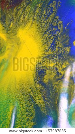 green, blue, yellow fluid chaotic mix of colors macro. Abstract color creative art background basis closeup.Beautiful