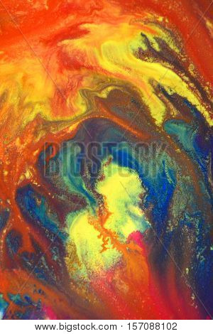 Red, green, blue, yellow fluid chaotic mix of colors macro. Abstract color creative art background basis closeup