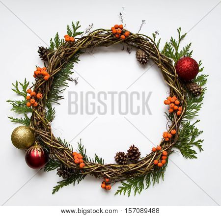 Christmas Wreath Of Vines With Decorative Ornaments, Thuja Branches, Rowanberries And Cones. Flat La