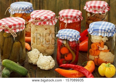 Homemade Canned Vegetables. Pickled Cucumbers, cauliflowers, carrots and peppers In Glass Jar.