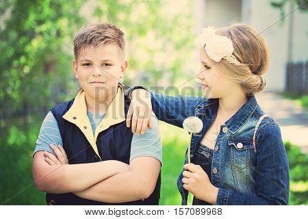 little boy and beautiful little girl talking