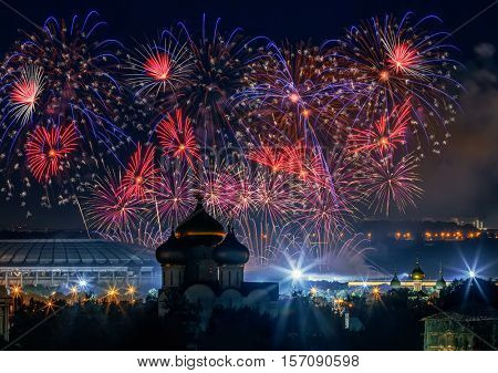 Firework above Luzhniki stadium and church at night in Moscow, Russia