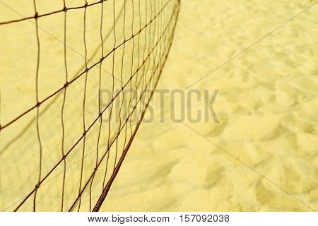unsharp black grid for playing beach volleyball closeup against the background of the sand