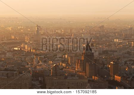 Panorama with Stalin skyscrapers (MID, house on Kotelnicheskaya quay) during sunrise in Moscow, Russia