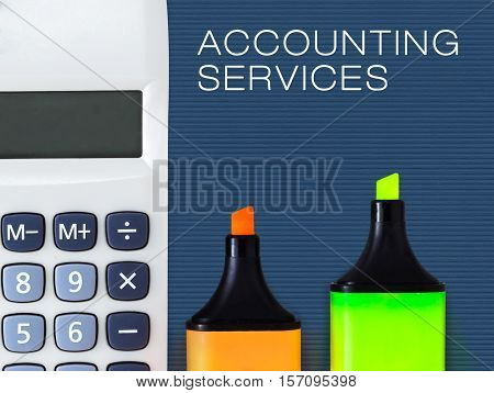 Accounting and financial service concept. Calculator and highlighters.