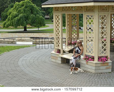 Woman And Dog Resting