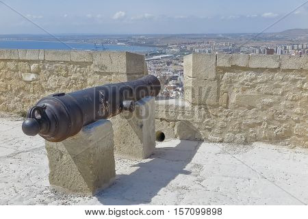 foreground of an ancient cannon in rampart of a fortress