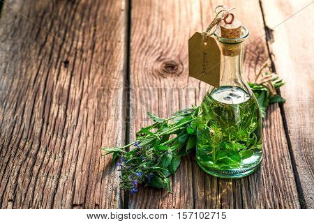 Healing Tincture As An Alternative Cure On Old Wooden Table