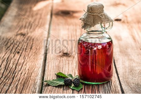 Healing Tincture As Natural Medicine On Old Wooden Table