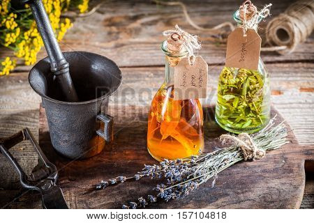 Homemade Herbs In Bottles With Alcohol And Herbs