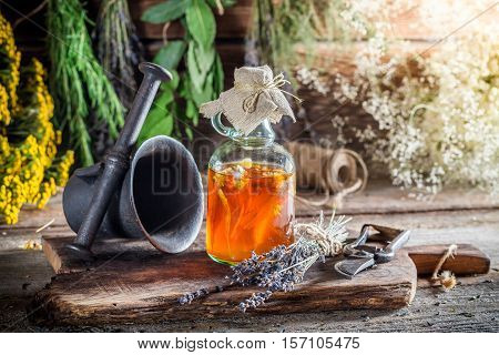 Therapeutic Herbs In Bottles With Herbs And Alcohol