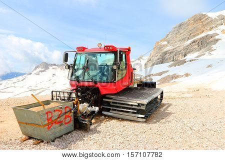 ZUGSPITZE GERMANY - JULY 5, 2016: The Pistenbully 300 W Polar snowcat ready for ski slope maintenance in Zugspitze arena. Most famous ski resort in alps on Germany Austria border.