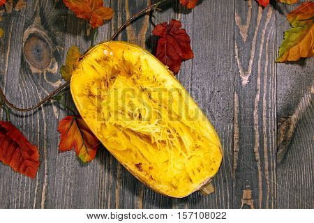 Overhead view of Spaghetti squash on a wooden background with squash seeds