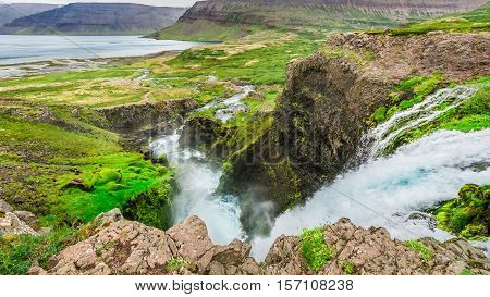 Waterfall Flowing Into A Valley In Iceland