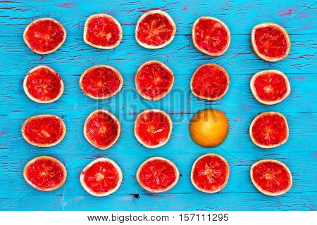 Five Rows Of Ruby Red Grapefruit Halves