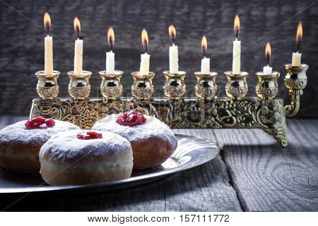 Sufganiyot and nine branched menora for Hanukkah.