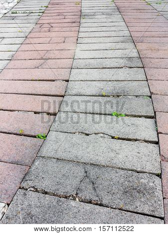 Decorative Colorful Sidewalk Pavement. Tiled Floor With Grey Tiles Crossed By A Diagonal Double Stri