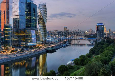 MOSCOW - JUN 24, 2015: Moscow International Business Center and Bagration bridge at night. Investments in Moscow International Business Center was approximately 12 billion dollars