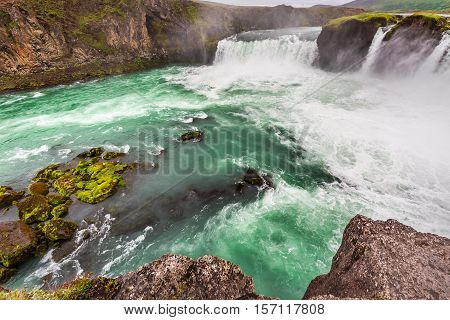 Wonderful Godafoss Waterfall In Summer With Blue Water
