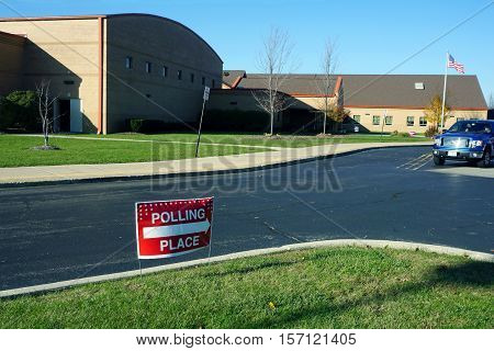 JOLIET, ILLINOIS / UNITED STATES - NOVEMBER 8, 2016: A lawn sign indicates the direction to the polling place, in the Wesmere Elementary School, on election day.