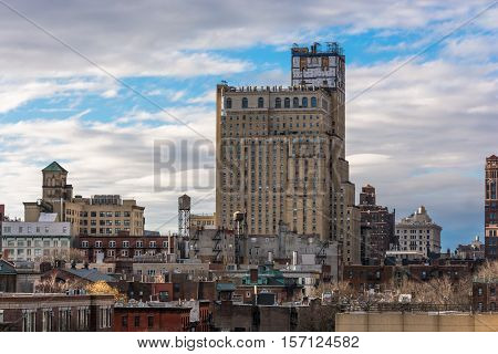Brooklyn New York partial skyline rofftops and water towers