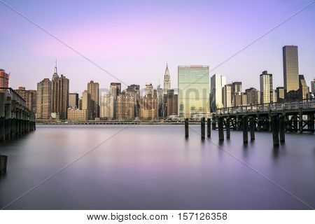 Midtown Manhattan from Queens New York. Early morning with a long exposure to smooth the water