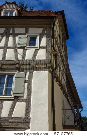 Residential tudor style house with blue sky in background. Castle Neuenbuerg in Germany.