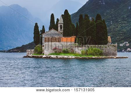Saint George Benedictian monastery on St. George island Ostrvo Sveti Dorde. One of the two islets near coast of Perast town at Kotor bay. Tourist travel attraction in Montenegro.