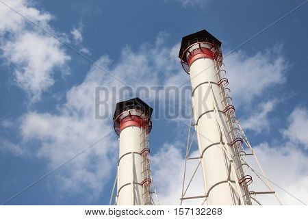 Two pipes of gas boiler on the sky background